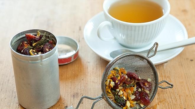 Loose leaf tea and brewed tea in tea cup.