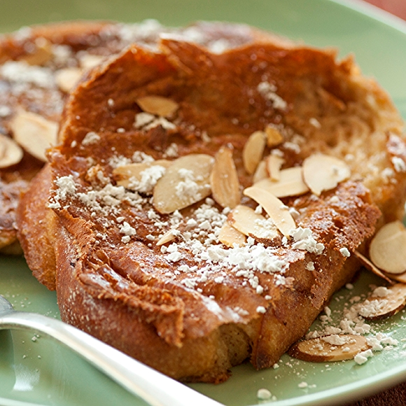 French toast with powdered sugar and almonds