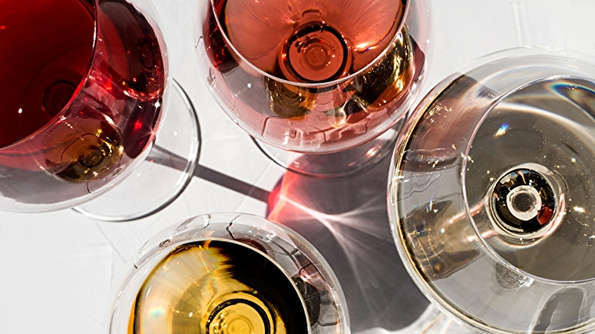 red and white wines in glasses on tabletop