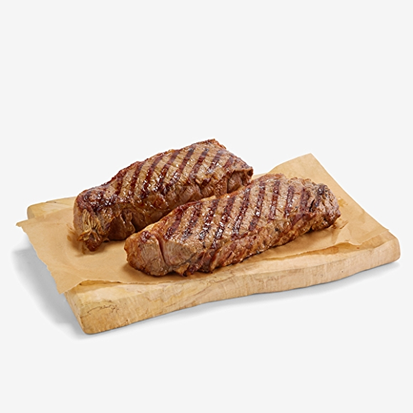 Image of cooked red meat on cutting board