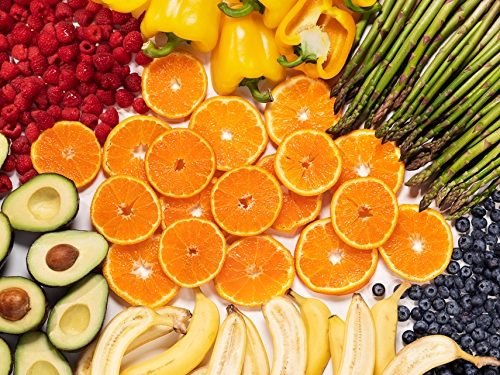Fruits and vegetables including oranges, avocados, asparagus, blueberries.