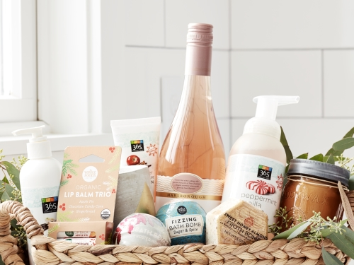 Gift basket full of Whole Foods products. Lip balm, bath bomb, hand soap.