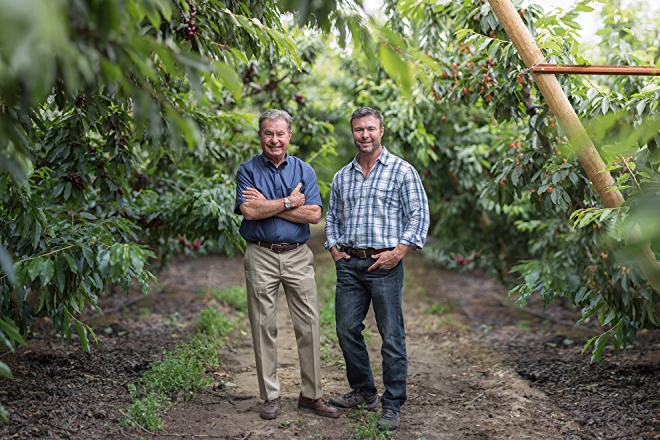Photo of Rainier Fruits growers Bill and Mark Zirkle in apple orchard