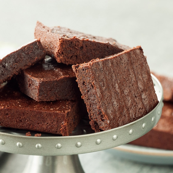 Brown butter spelt brownies on serving dish.