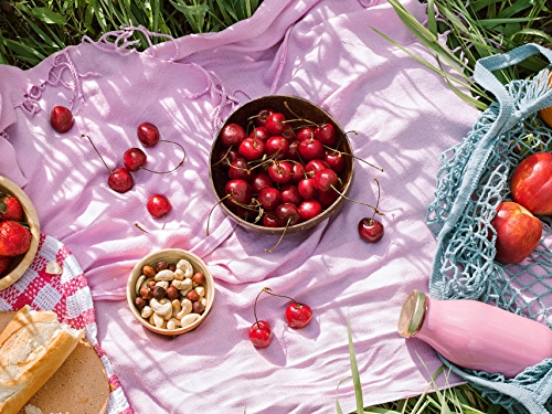 Lifestyle image of cherries, berries, nuts and apples.