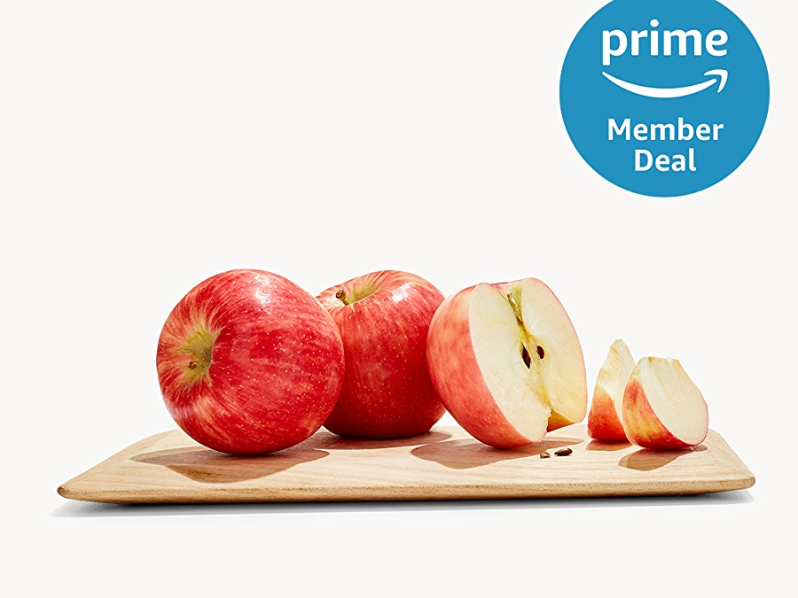 Honeycrisp apples on a cutting board with a prime member deal logo in the upper right corner