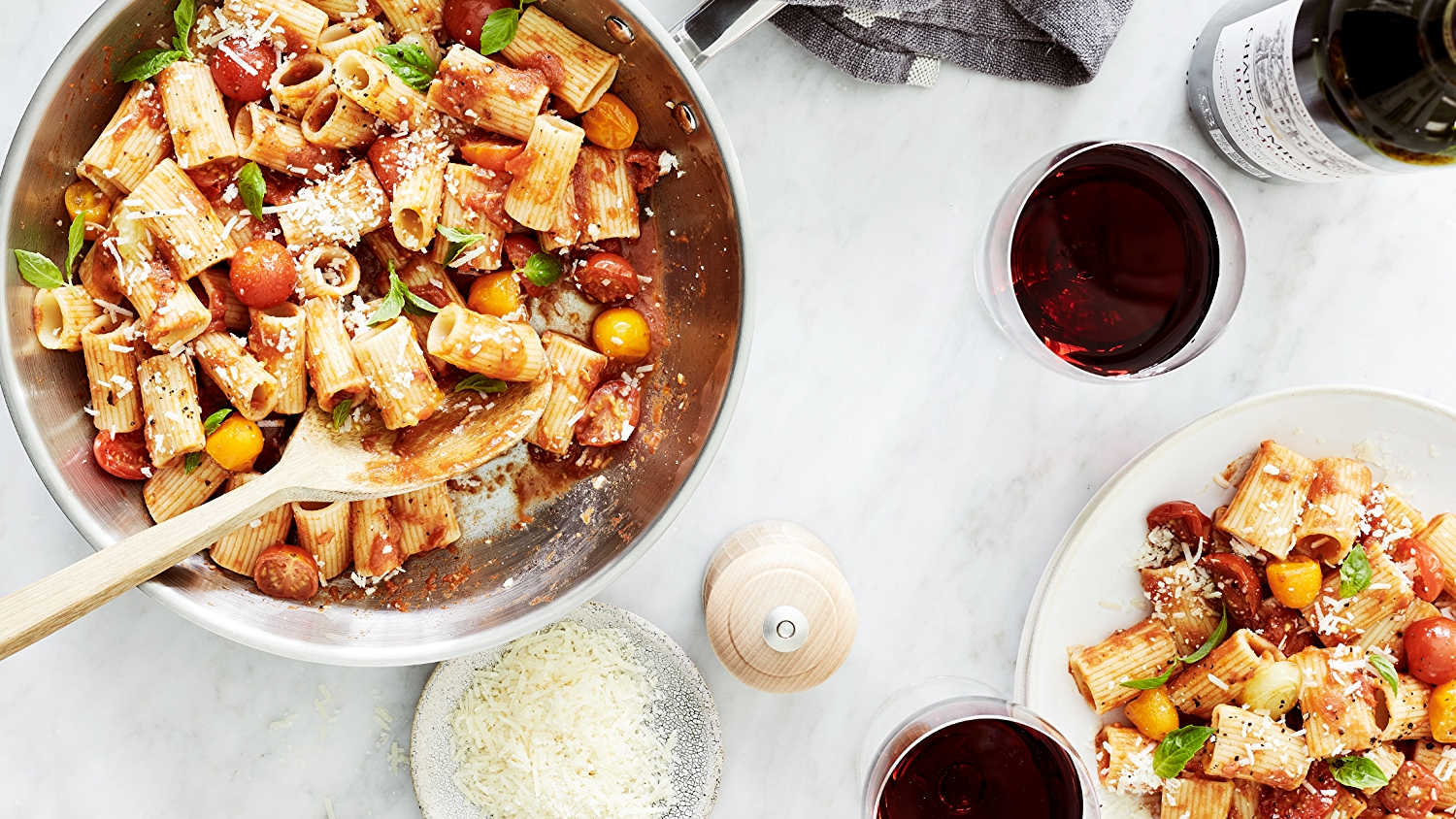 Image of pasta on a dinner table with wine
