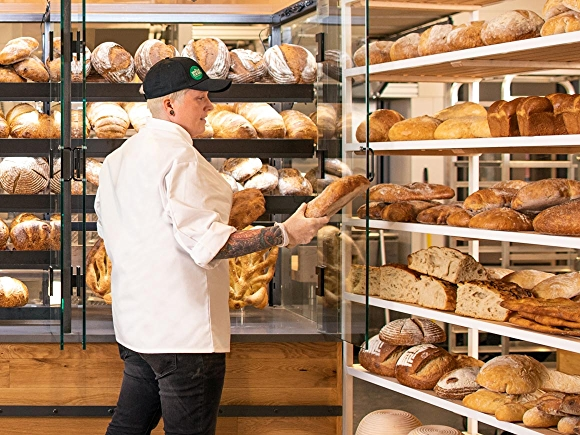 WFM Team Member stocking the shelves in the bakery department