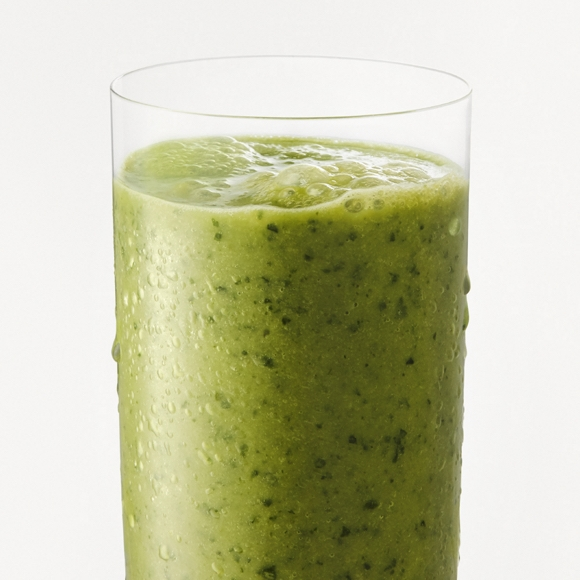 Green smoothie with kale and spinach in glass.