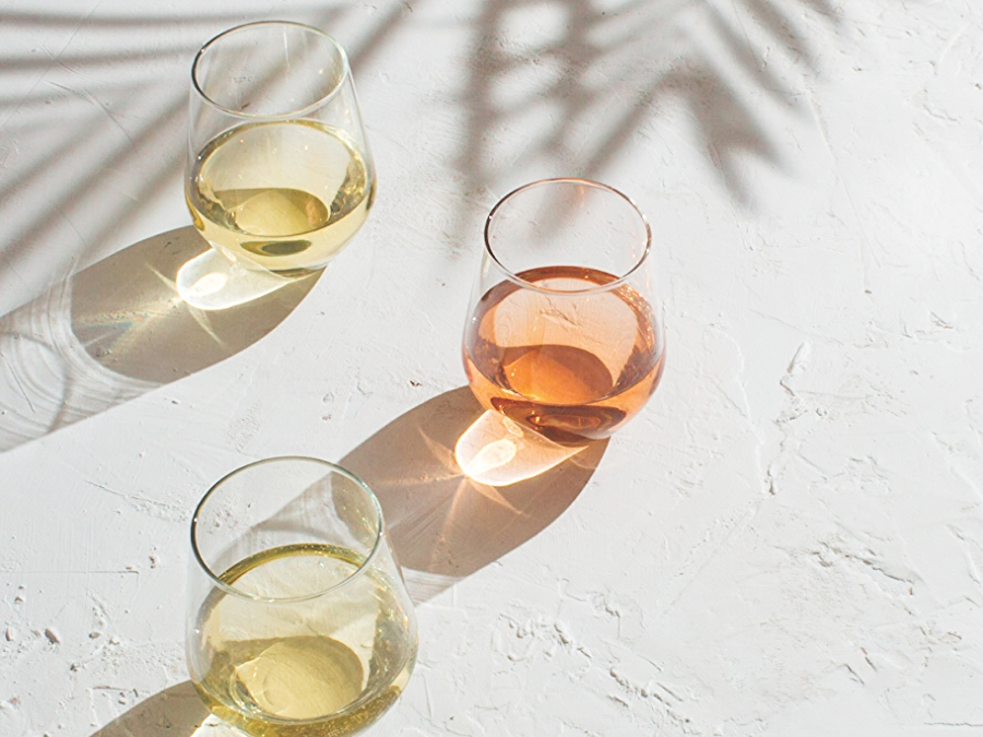 glasses of summer wines on white surface