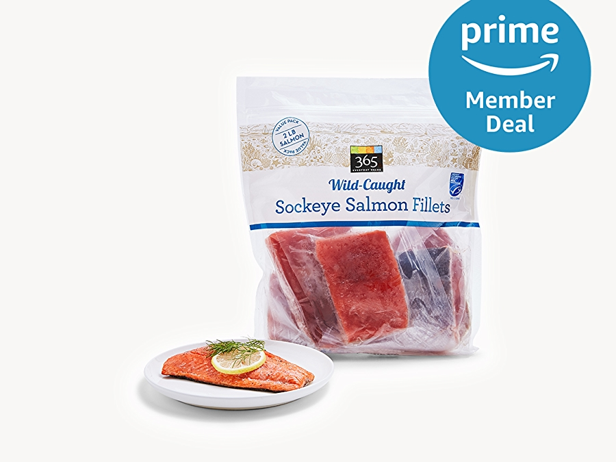 Frozen Wild-Caught sockeye salmon fillet in packaging and cooked on a plate, Prime member deal logo in upper right corner