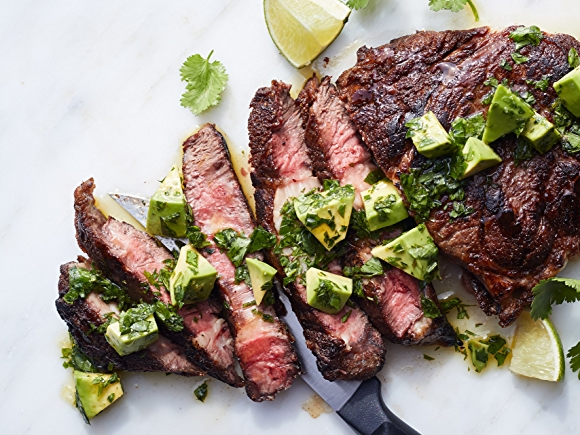 Image of cooked steak with avocado on top