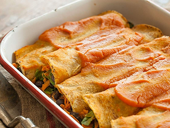 Image of dish with baked black bean and sweet potato enchiladas recipe.