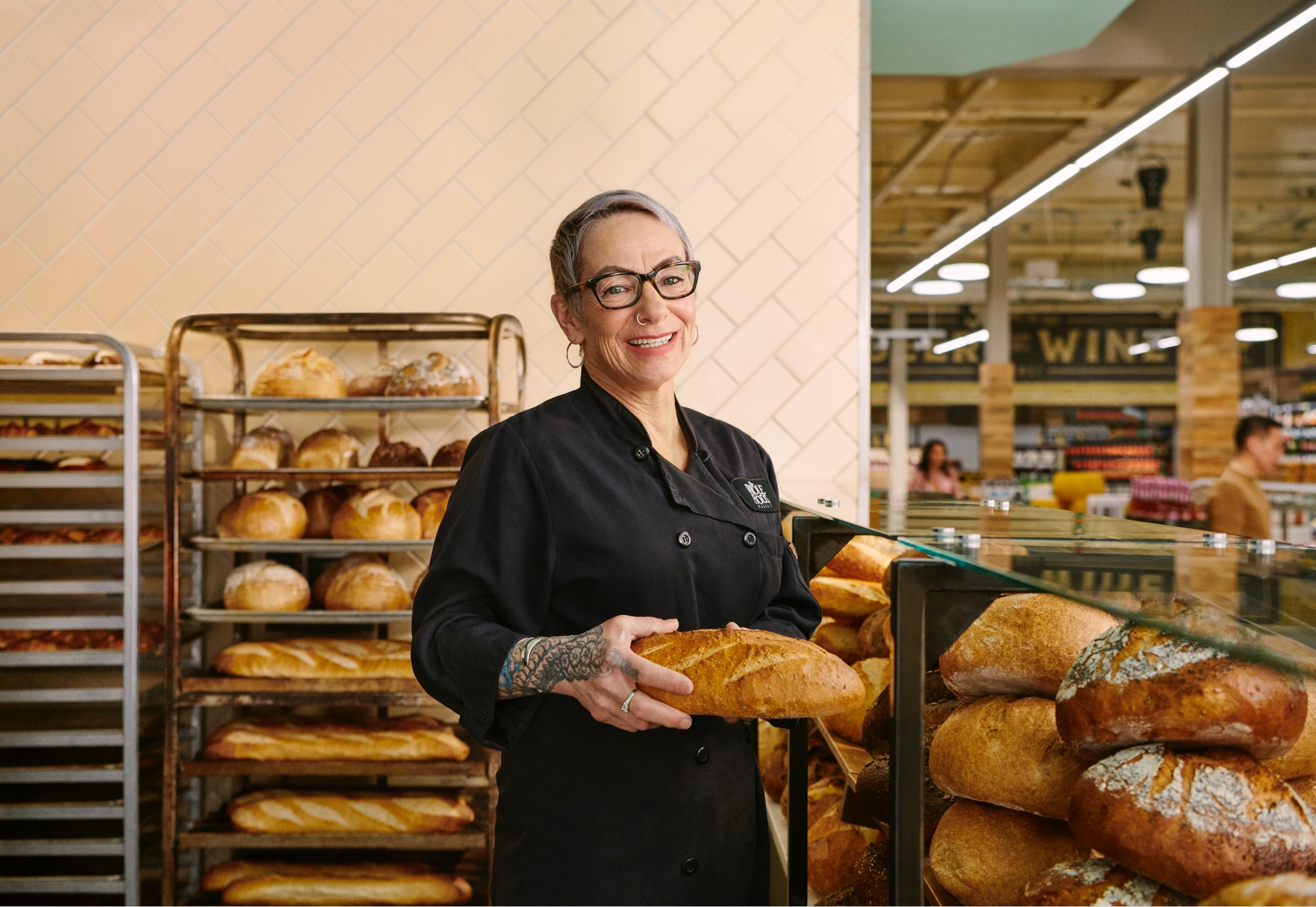 A Whole Foods employee baking bread