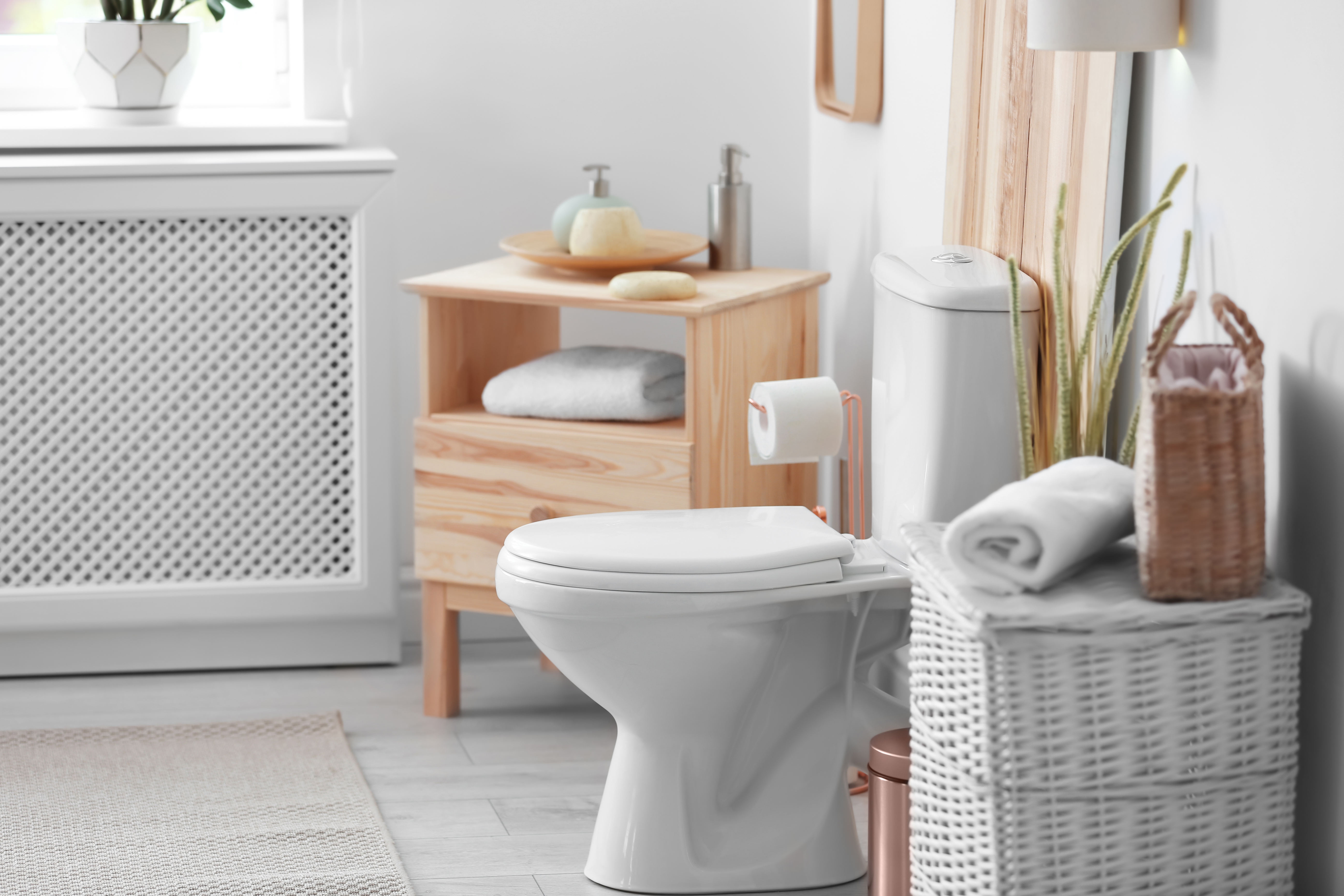 These Toilet Paper Holders Keep Bathroom Necessities Within Arm's Reach