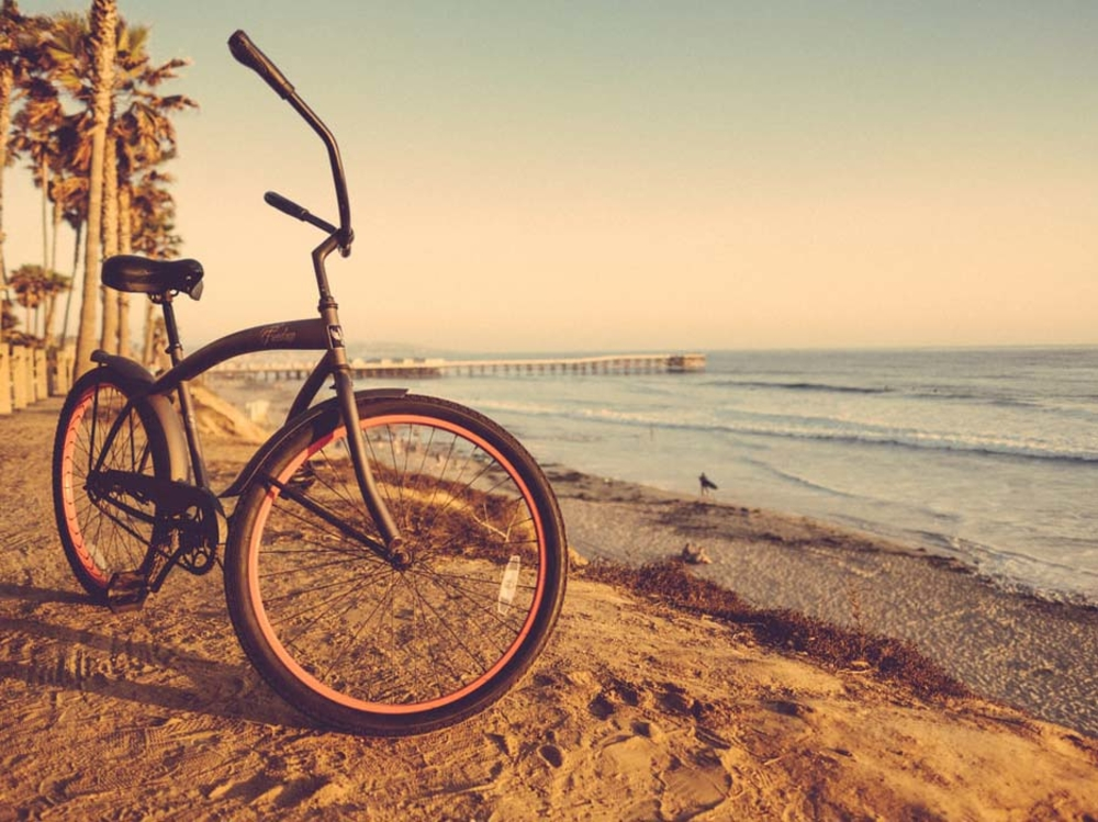 Beach cruiser bike on sandy beach