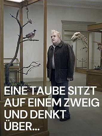 Eine Taube sitzt auf einem Zweig und denkt über das Leben nach